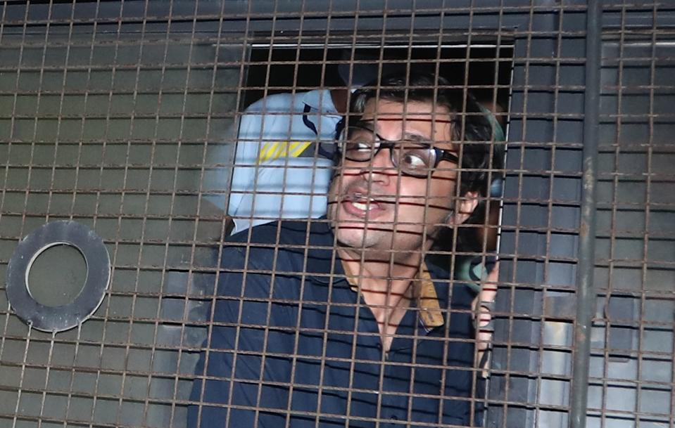 Arnab Goswami in police van at Alibag court, Alibag police picked up Arnab Goswami from his Mumbai residence, in Alibag, on November 4, 2020 in Mumbai. (Photo by Satish Bate/Hindustan Times via Getty Images)