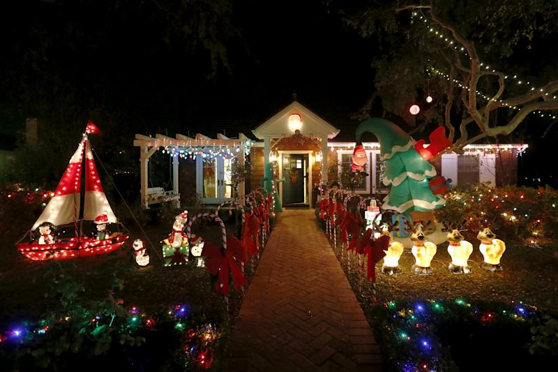 Christmas lights are seen on a home in the Sleepy Hollow area of Torrance, California, United States, December 15, 2015. In many neighborhoods of Los Angeles, homeowners compete for the most lavish and creative holiday light displays. Torrance's Sleepy Hollow is one such neighborhood where every home outdoes the next: surfing Santas, life-size nativity scenes, ferris wheels, and giant inflatable snowmen line the lawns on every street. Picture taken December 15, 2015. REUTERS/Lucy Nicholson
