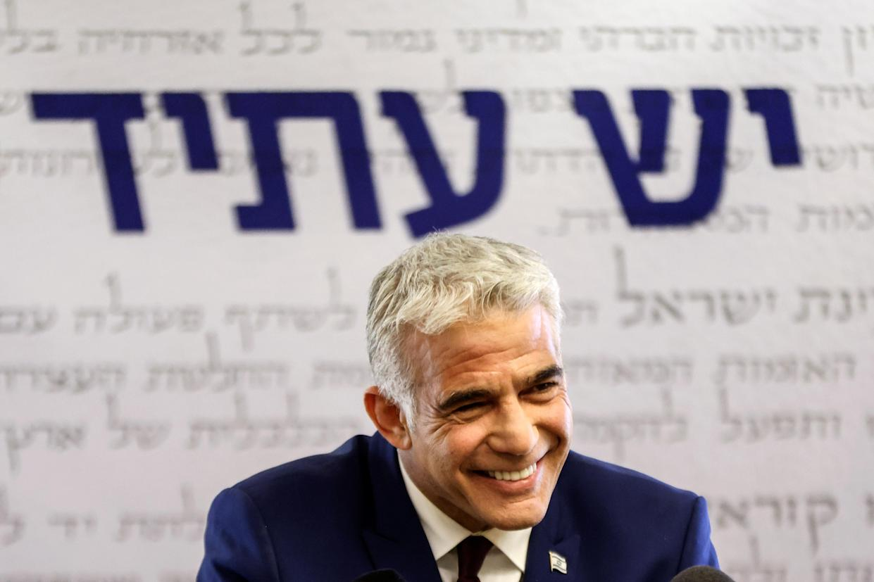 Yesh Atid party leader, Yair Lapid, speaks to the media in the Knesset, Israel's parliament, in Jerusalem, June 7, 2021. (Ronen Zvulun/Reuters)