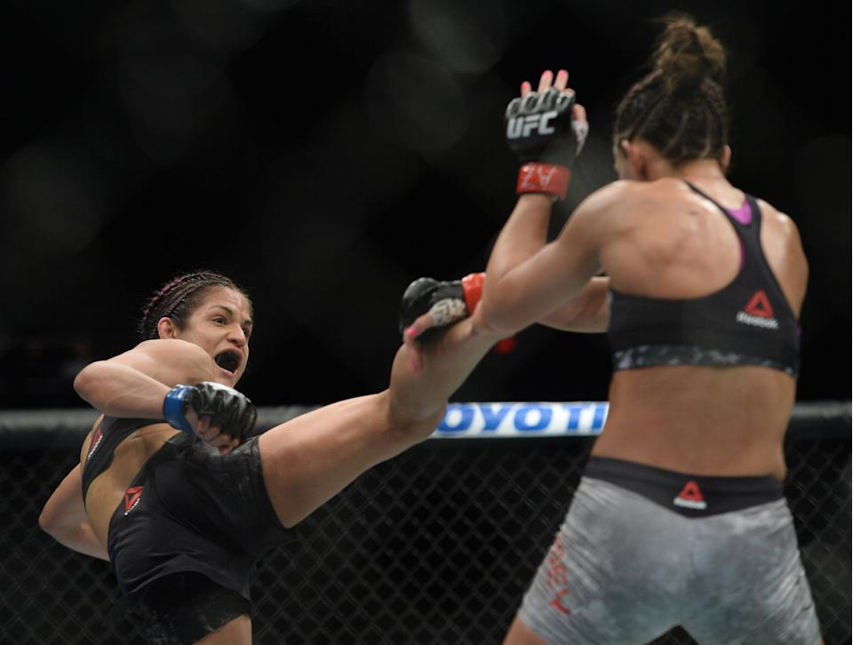 Feb 17, 2019; Phoenix, AZ, USA; Cortney Casey (red gloves) and Cynthia Calvillo (blue gloves) fight during their strawweight bout during UFC Fight Night at Talking Stick Resort Arena. Calvillo won via unanimous decision Mandatory Credit: Joe Camporeale-USA TODAY Sports