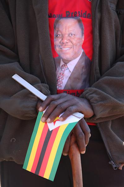 A Movement For Democratic Change (MDC) supporter wears a T-shirt with the picture of Zimbabwean Prime Minister Morgan Tsvangirai during the launch of the party's election campaign in Marondera, east of Harare, Zimbabwe Sunday, July 7, 2013. Tsvangirai who leads MDC, will face President Robert Mugabe in the national vote set for July 31. (AP Photo/Tsvangirayi Mukwazhi)