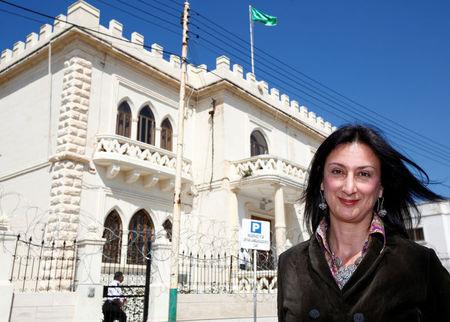 Maltese investigative journalist Daphne Caruana Galizia poses outside the Libyan Embassy in Valletta April 6, 2011. Investigative journalist Caruana Galizia was killed after a powerful bomb blew up a car killing her in Bidnija, Malta, in October 16, 2017. Picture taken April 6, 2011. REUTERS/Darrin Zammit Lupi