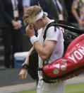 Canada's Denis Shapovalov leaves the court after being defeated by Serbia's Novak Djokovic during the men's singles semifinals match on day eleven of the Wimbledon Tennis Championships in London, Friday, July 9, 2021. (AP Photo/Kirsty Wigglesworth)