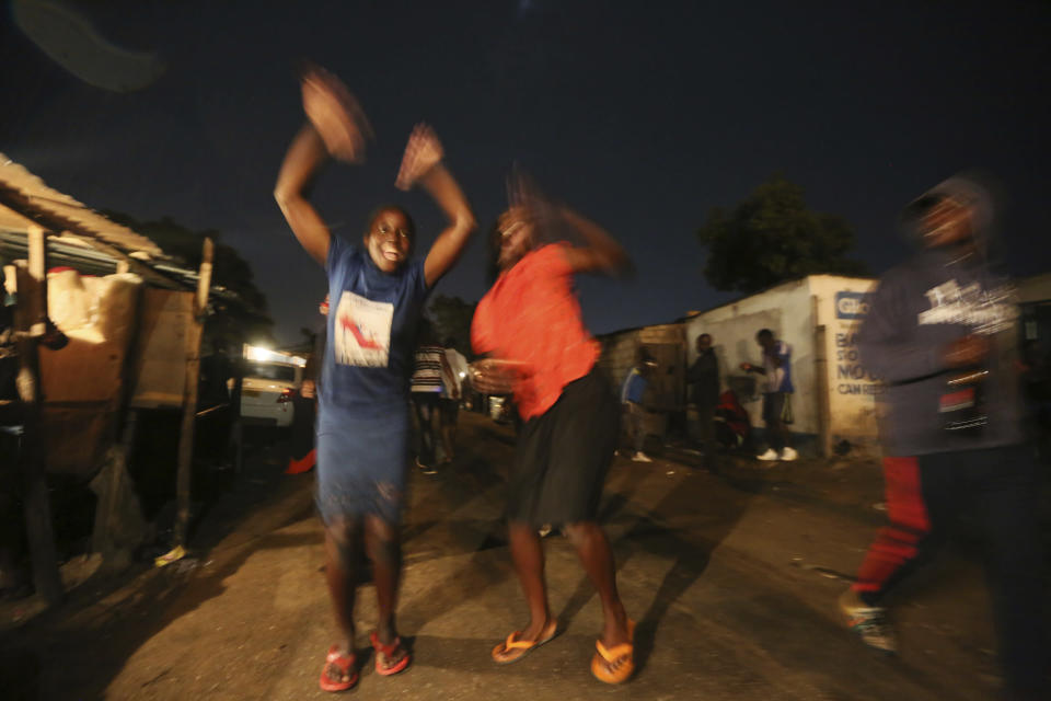 People celebrate the new year on the streets in Mbare, Harare, Friday, Jan. 1, 2021. Despite a government ban on music concerts and public gatherings due to a surge in COVID-19 infections and the new and more contagious variants of the disease, thousands of people gathered in one of the countrys poorest neighborhoods to celebrate the new year.(AP Photo/Tsvangirayi Mukwazhi)