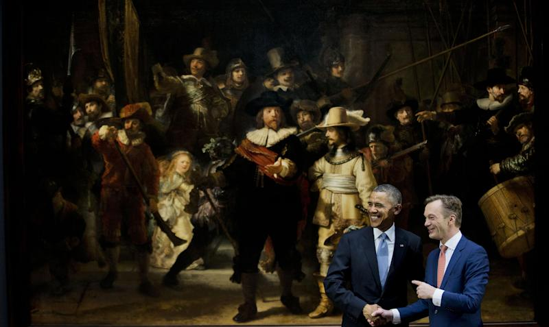 U.S. President Barack Obama, left, and museum director Wim Pijbes pose in front of Dutch master Rembrandt's The Night Watch painting during a visit to the Rijksmuseum in Amsterdam, Netherlands, Monday, March 24, 2014. Obama will attend the two-day Nuclear Security Summit in The Hague. (AP Photo/Jerry Lampen, Pool)