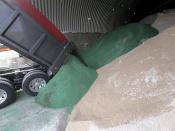 A fresh load of salt is delivered and put in the storage shed in the Pittsfield, Mass., city yards as snow storm looms, Wednesday, Dec. 16, 2020. The green salt is treated for ultra-low temperatures. (Ben Garver/The Berkshire Eagle via AP)