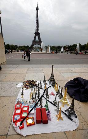 FILE PHOTO: Eiffel tower models are displayed for tourists by a souvenir vendor in front the Eiffel Tower at the Trocadero in Paris, France, July 26, 2011.  REUTERS/Eric Gaillard/File Photo