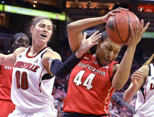 Louisville's Sara Hammond, left, attempts to grab a rebound away from Rutgers' Betnijah Laney during the first half of an NCAA college basketball game, Sunday, Feb. 23, 2014, in Louisville, Ky. (AP Photo/Timothy D. Easley)