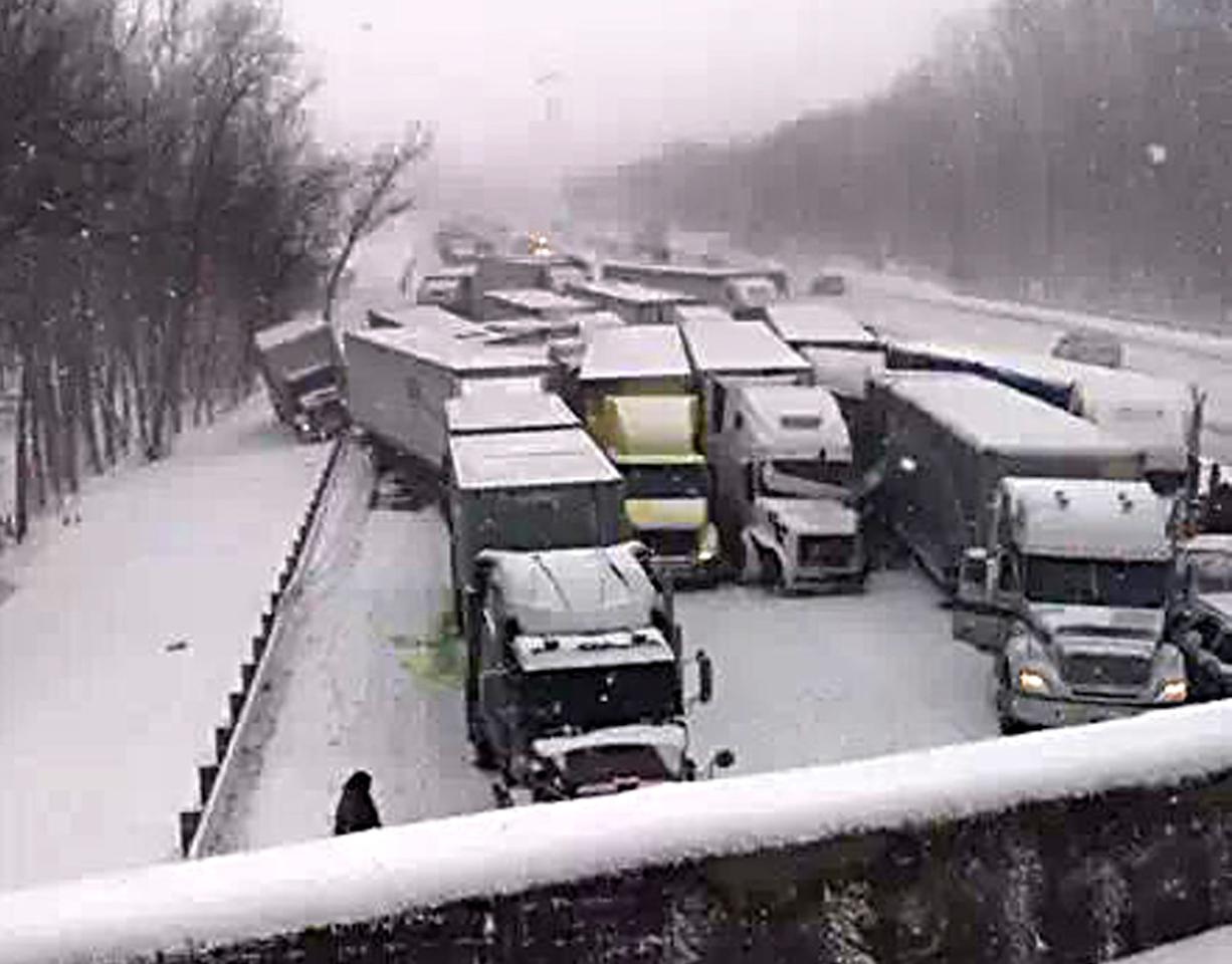 This cell phone image shows a massive highway pileup on Interstate 94 near Michigan City, Ind., Thursday, Jan. 23, 2014, that is being blamed on whiteout conditions. The accident has left at least two people dead and an unknown number injured in northwestern Indiana. Indiana State Police say they have closed Interstate 94 eastbound and are bringing in cranes and wreckers to help clear the scene. (AP Photo/Sun-Times Media, Matt Carpenter) MANDATORY CREDIT, MAGS OUT