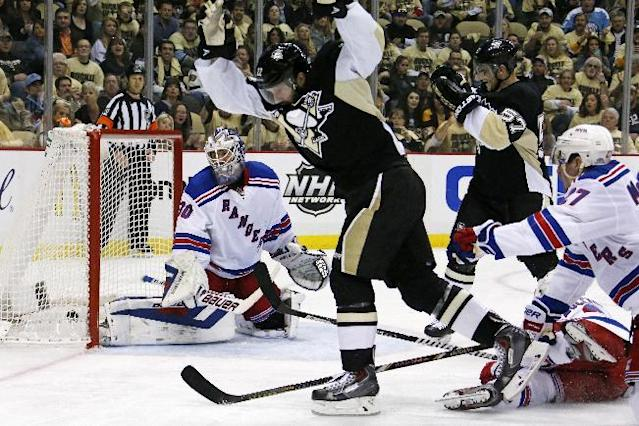 Pittsburgh Penguins' Lee Stempniak (22) celebrates his goal past New York Rangers goalie Henrik Lundqvist (30) in the second period of Game 1 of a second-round NHL hockey playoff series in Pittsburgh, Friday, May 2, 2014. (AP Photo/Gene J. Puskar)