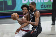 Cleveland Cavaliers' Collin Sexton (2) makes contact with Brooklyn Nets' Kevin Durant (7) during the second half of an NBA basketball game Sunday, May 16, 2021, in New York. Sexton was called for a flagrant foul and ejected from the game. (AP Photo/Frank Franklin II)