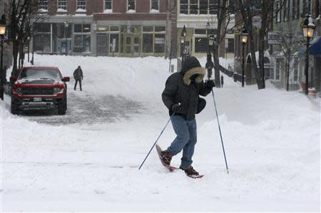 Jason Gallant snowshoes to work after a snowstorm in Portland, Maine