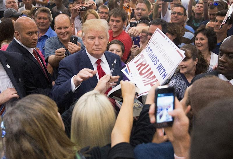 Republican presidential candidate Donald Trump greets guests gathered for a campaign event at the Grand River Center on August 25, 2015 in Dubuque, Iowa (AFP Photo/Scott Olson)