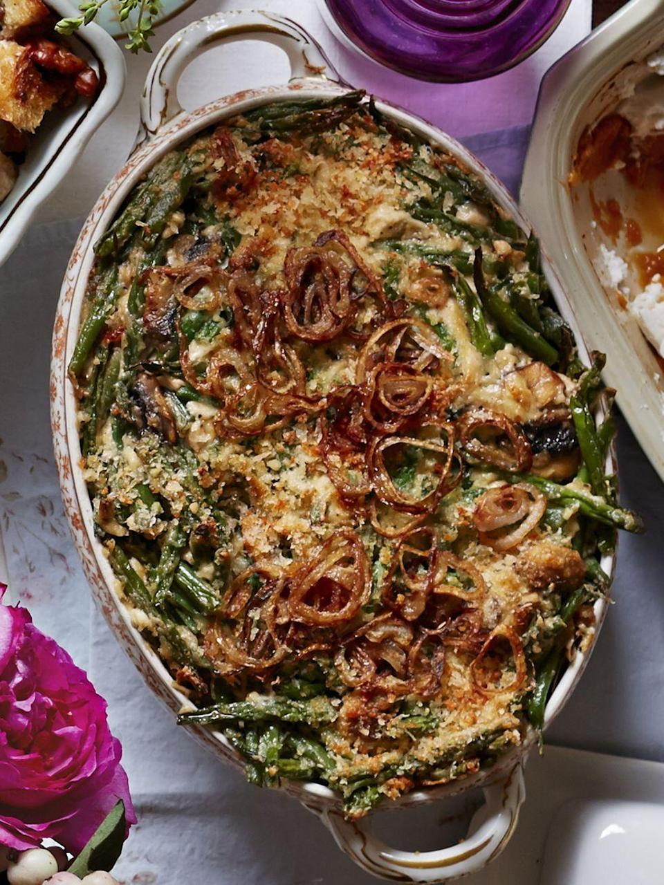 """<p>The traditional mix of green beans, onions, and mushrooms is amped up with caramelized onions and a touch of Parmesan cheese. </p><p><strong><a href=""""https://www.countryliving.com/food-drinks/recipes/a5868/green-bean-casserole-fried-shallots-recipe-clx1114/"""" rel=""""nofollow noopener"""" target=""""_blank"""" data-ylk=""""slk:Get the recipe"""" class=""""link rapid-noclick-resp"""">Get the recipe</a>.</strong></p><p><strong><a class=""""link rapid-noclick-resp"""" href=""""https://www.amazon.com/Bakeware-Krokori-Rectangular-Aquamarine-Rectangula/dp/B074Z5X8MT/?tag=syn-yahoo-20&ascsubtag=%5Bartid%7C10050.g.3726%5Bsrc%7Cyahoo-us"""" rel=""""nofollow noopener"""" target=""""_blank"""" data-ylk=""""slk:SHOP BAKING DISHES"""">SHOP BAKING DISHES</a><br></strong></p>"""