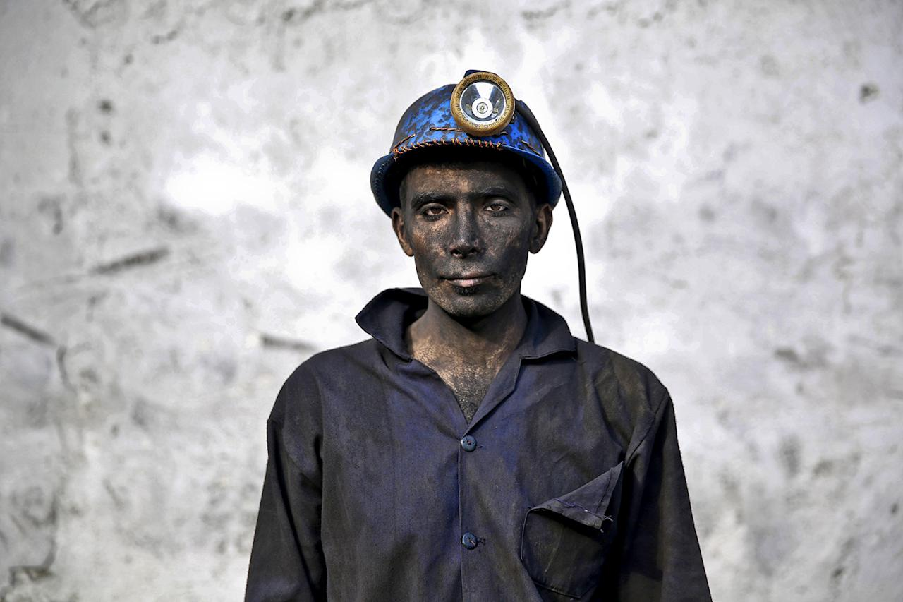 <p>An Iranian coal miner with his face smeared black from coal poses for a photograph at a mine near the city of Zirab 132 miles northeast of the capital Tehran, on a mountain in Mazandaran province, Iran on May 7, 2014. (Photo: Ebrahim Noroozi/AP) </p>