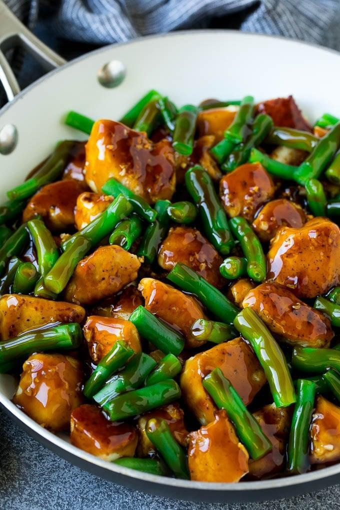 """<p>If you love stir-fry, try this version made with green beans, chicken, and a zesty honey garlic sauce. If you can't get enough veggies, you can add mushrooms, peppers, onions, broccoli, or snow peas to the mix.</p> <p><strong>Get the recipe:</strong> <a href=""""https://www.dinneratthezoo.com/chicken-and-green-beans/"""" class=""""link rapid-noclick-resp"""" rel=""""nofollow noopener"""" target=""""_blank"""" data-ylk=""""slk:chicken and green beans"""">chicken and green beans</a></p>"""