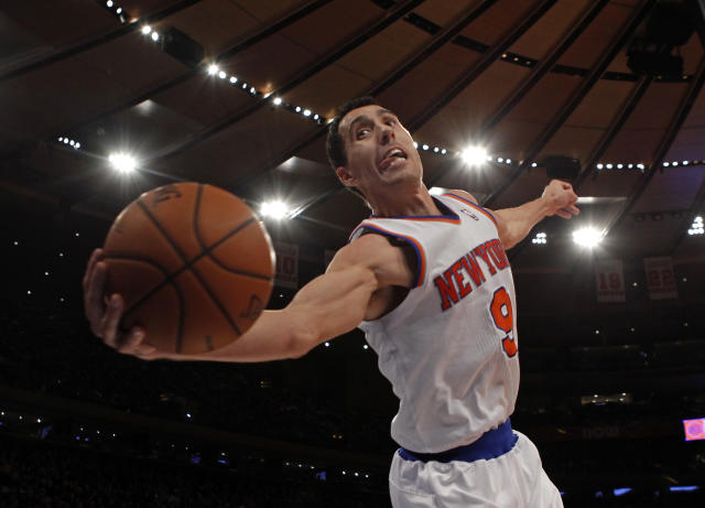 New York Knicks point guard Pablo Prigioni saves the ball from going out of bounds against the New Orleans Hornets in the second half of their NBA basketball game at Madison Square Garden in New York, January 13, 2013. REUTERS/Adam Hunger (UNITED STATES - Tags: SPORT BASKETBALL)