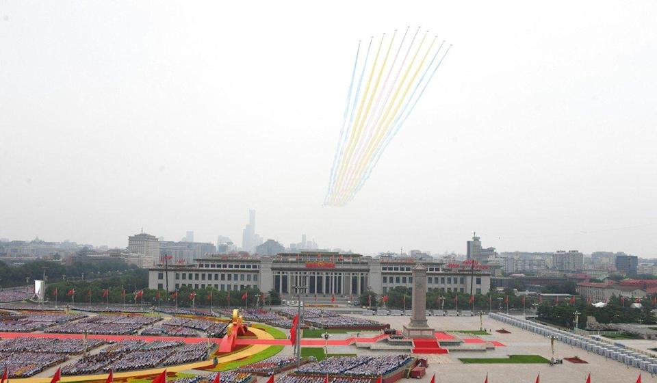 The aerial display featured 71 planes to reflect the date. Photo: Xinhua