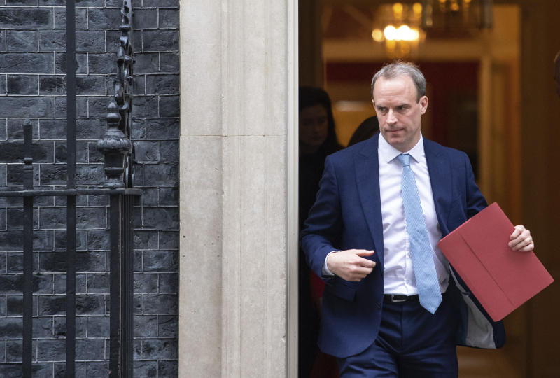 Britain's Foreign Secretary Dominic Raab leaves a meeting in Downing Street, London, Monday April 6, 2020. Britain's Prime Minister Boris Johnson has been moved to the intensive care unit of a London hospital on Monday, April 6, 2020 after his coronavirus symptoms worsened. Johnson's office says Johnson is conscious and does not require ventilation at the moment. Johnson was admitted to St. Thomas' Hospital late Sunday, 10 days after he was diagnosed with COVID-19. Johnson has asked Foreign Secretary Dominic Raab to deputize for him. (Dominic Lipinski/PA via AP)