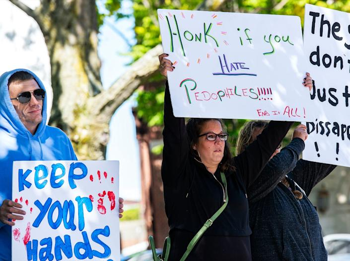 "Demonstrators in Keene, New Hampshire, gather at a ""Save the Children Rally."" Anti-pedophilia protests are flaring in the US where the QAnon movement started. <p class=""copyright"">JOSEPH PREZIOSO/AFP via Getty Images</p>"