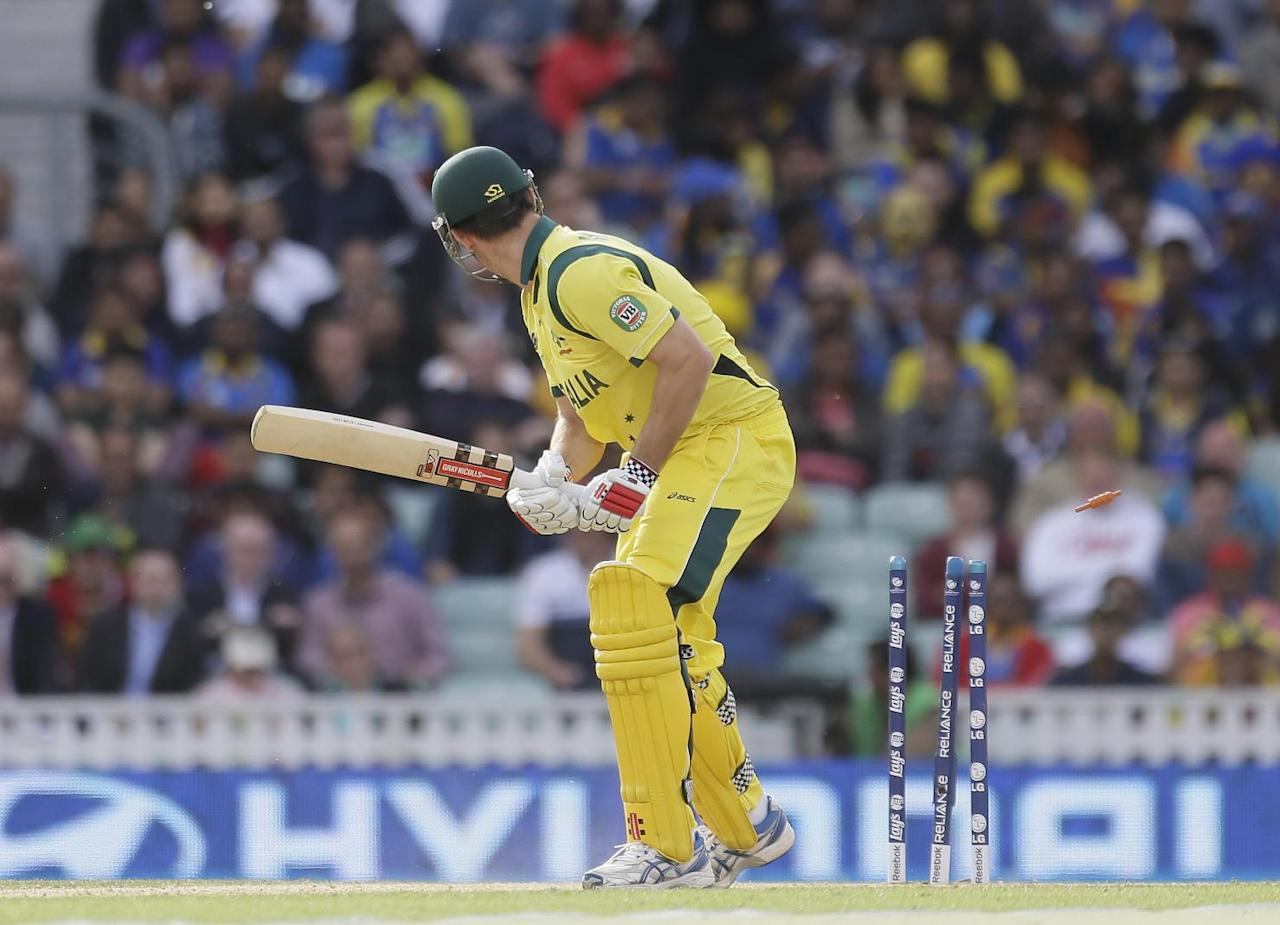 Australia's Mitchell Marsh is clean bowled by Sri Lanka's Angelo Mathews during their ICC Champions Trophy cricket match at the Oval cricket ground in London, Monday, June 17, 2013. (AP Photo/Alastair Grant)