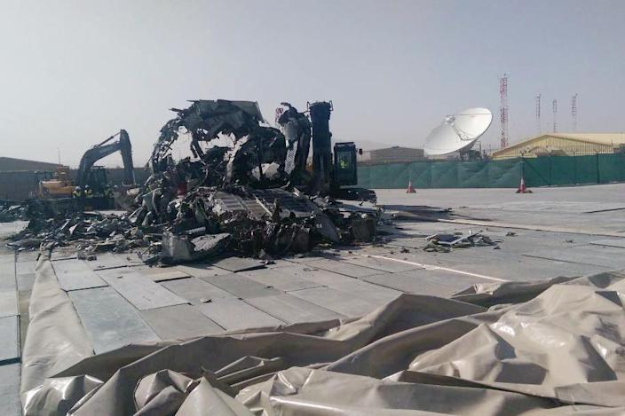 Image:  A  G222 destroyed for scrap sits on the tarmac at Kabul International Airport in Afghanistan. (Defense Logistics Agency / via SIGAR)