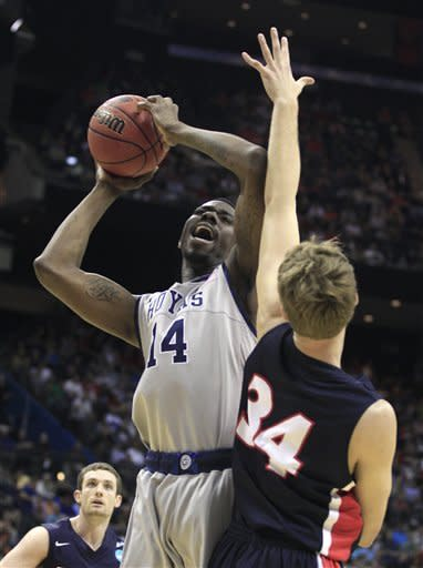 Georgetown's Henry Sims (14) is fouled by Belmont's Mick Hedgepeth (34) during the first half of an NCAA men's college basketball tournament second-round game in Columbus, Ohio, Friday, March 16, 2012. (AP Photo/Tony Dejak)