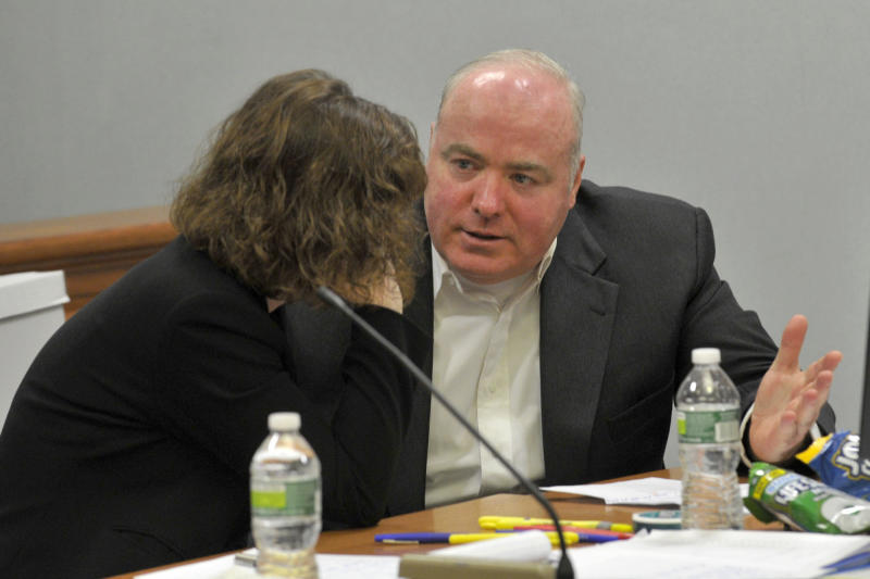 Michael Skakel, right, talks to one of his defense attorneys, Jessica Santos, at his habeas corpus trial at State Superior Court in Vernon, Conn., on Monday, April 22, 2013.   Skakel's attorneys are challenging his 2002 murder conviction.  (AP Photo/The Stamford Advocate,Jason Rearick, Pool)