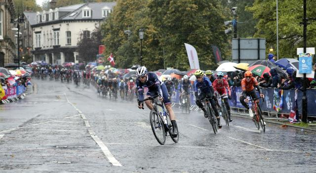 Cyclists ride under pouring rain during the men elite race, at the road cycling World Championships in Harrogate, England, Sunday, Sept. 29, 2019. (AP Photo/Manu Fernandez)