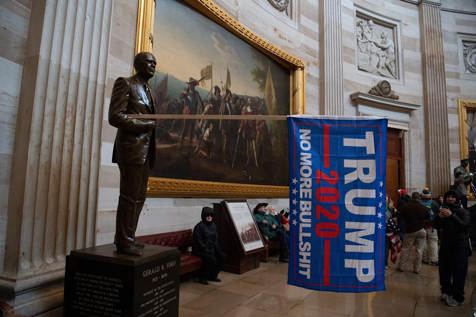 Demonstrators breeched security and entered the Capitol as Congress debated the a 2020 presidential election Electoral Vote Certification. (Photo by SAUL LOEB/AFP via Getty Images)