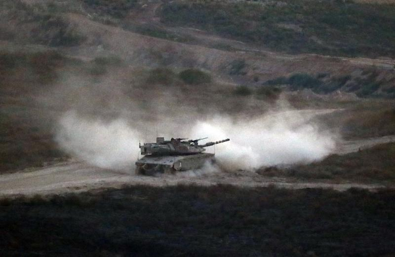 An Israeli army tank patrols along the border between Israel and the Gaza Strip on May 29, 2018 (AFP Photo/Jack GUEZ)