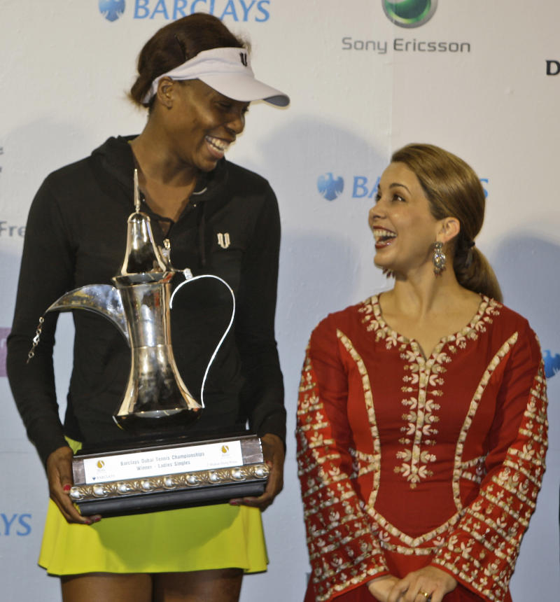 FILE - A Saturday, Feb. 20, 2010 photo from files showing Venus Williams from U.S., left, holding the trophy as she talks to Princess Haya, wife of Sheik Mohammed bin Rashid Al Maktoum, UAE Prime Minister and Ruler of Dubai, after she beat Victoria Azarenka from Belarus during the final of Dubai Tennis Championship in Dubai, United Arab Emirates. The newest addition to the Olympics' capital city confirms the kingdom of Jordan's growing influence in international sports. The International Equestrian Federation and its president, Princess Haya, have opened a modern headquarters in Lausanne named for King Hussein I, her late father whose values are being spread through sports by three of his children's work. The princess, an International Olympic Committee member since 2007, was joined in the elite body last year by her elder brother Prince Feisal. An increasingly important voice in the Olympic movement, he will give a keynote speech on achieving peace through sport at a United Nations conference in Geneva on Wednesday, May 11, 2011. (AP Photo/Kamran Jebreili, File)