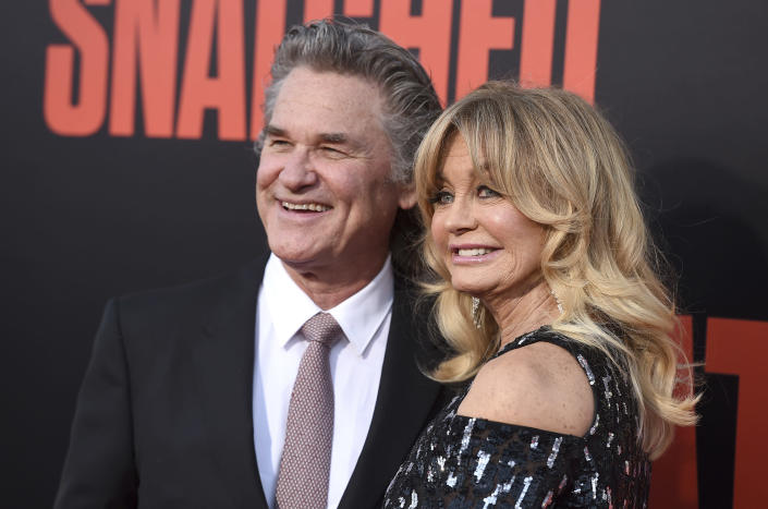 """FILE - Kurt Russell, left, and Goldie Hawn appear at the premiere of Hawn's film, """"Snatched"""" in Los Angeles on May 10, 2017. Russell and Hawn star in the holiday film """"The Christmas Chronicles: Part Two,"""" premiering Friday on Netflix. (Photo by Jordan Strauss/Invision/AP, File)"""