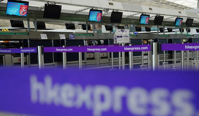 Empty HK Express check-in counters at the Hong Kong International Airport in March. Photo: Sam Tsang