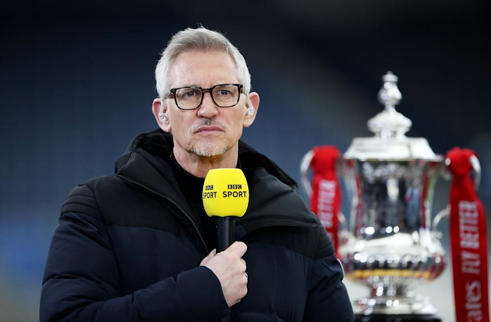LEICESTER, ENGLAND - MARCH 21: Gary Lineker, BBC Sport TV Pundit looks on whilst standing next to the FA Cup trophy prior to the Emirates FA Cup Quarter Final  match between Leicester City and Manchester United at The King Power Stadium on March 21, 2021 in Leicester, England. Sporting stadiums around the UK remain under strict restrictions due to the Coronavirus Pandemic as Government social distancing laws prohibit fans inside venues resulting in games being played behind closed doors.  (Photo by Alex Pantling/Getty Images)