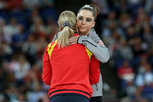 <p>Silver medalist McKayla Maroney Maroney (R) of the United States greets gold medalist Sandra Raluca Izbasa of Romania during the medal ceremony following the Artistic Gymnastics Women's Vault final on Day 9 of the London 2012 Olympic Games at North Greenwich Arena on August 5, 2012 in London, England. (Photo by Ronald Martinez/Getty Images) </p>