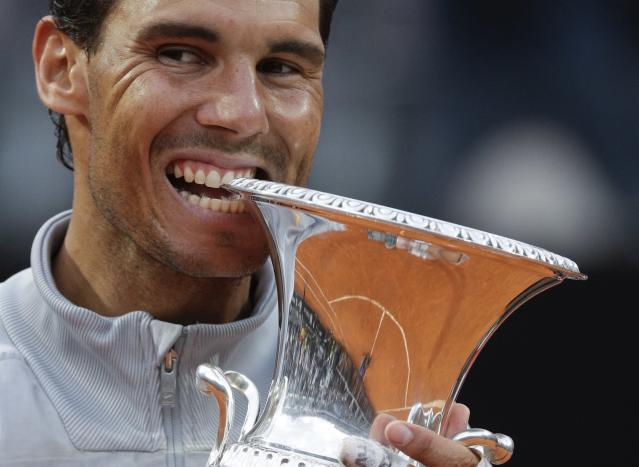Spain's Rafael Nadal bites the trophy after beating Germany's Alexander Zverev in the final match of the Italian Open tennis tournament, in Rome, Sunday, May 20, 2018. Nadal won 6-1, 1-6, 6-3. (AP Photo/Gregorio Borgia)