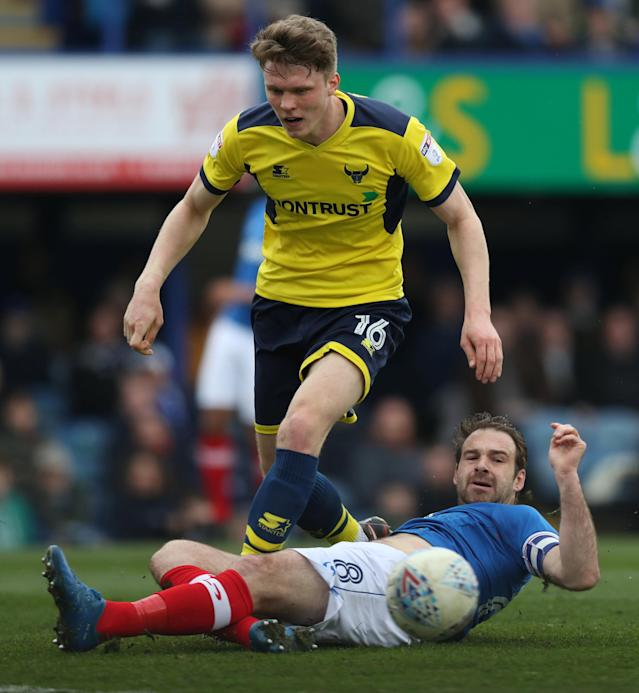 "Soccer Football - League One - Portsmouth vs Oxford United - Fratton Park, Portsmouth, Britain - March 25, 2018 Portsmouth's Brett Pitman in action with Oxford United's Rob Dickie Action Images/Peter Cziborra EDITORIAL USE ONLY. No use with unauthorized audio, video, data, fixture lists, club/league logos or ""live"" services. Online in-match use limited to 75 images, no video emulation. No use in betting, games or single club/league/player publications. Please contact your account representative for further details."