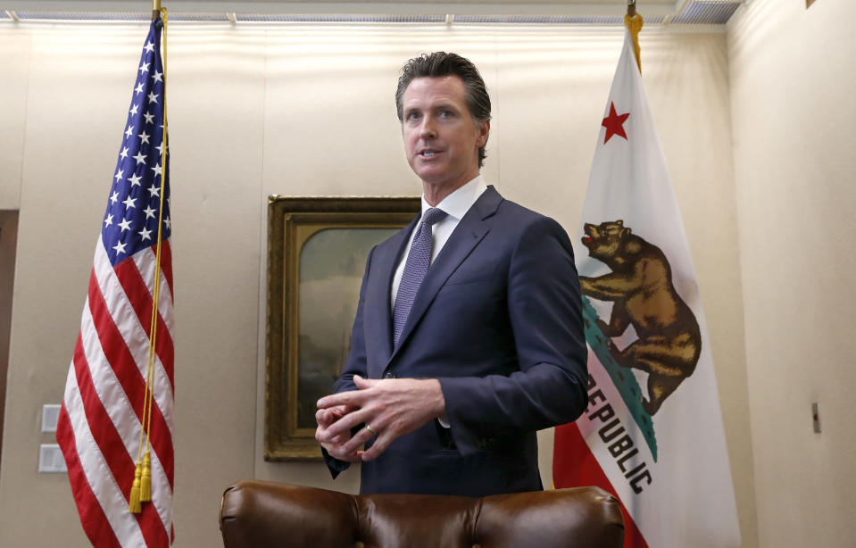 """FILE - In this July 12, 2019, file photo, Gov. Gavin Newsom discusses his decision to fire state Oil and Gas Supervisor Ken Harris while talking with reporters at his office in Sacramento, Calif. Newsom said he fired Harris July 11 because he did not """"exercise consistency"""" with the governor's opposition to hydraulic fracturing. Newsom on Saturday, Oct. 12, signed a law intended to counter Trump administration plans to increase oil and gas production on protected public land. (AP Photo/Rich Pedroncelli, File)"""
