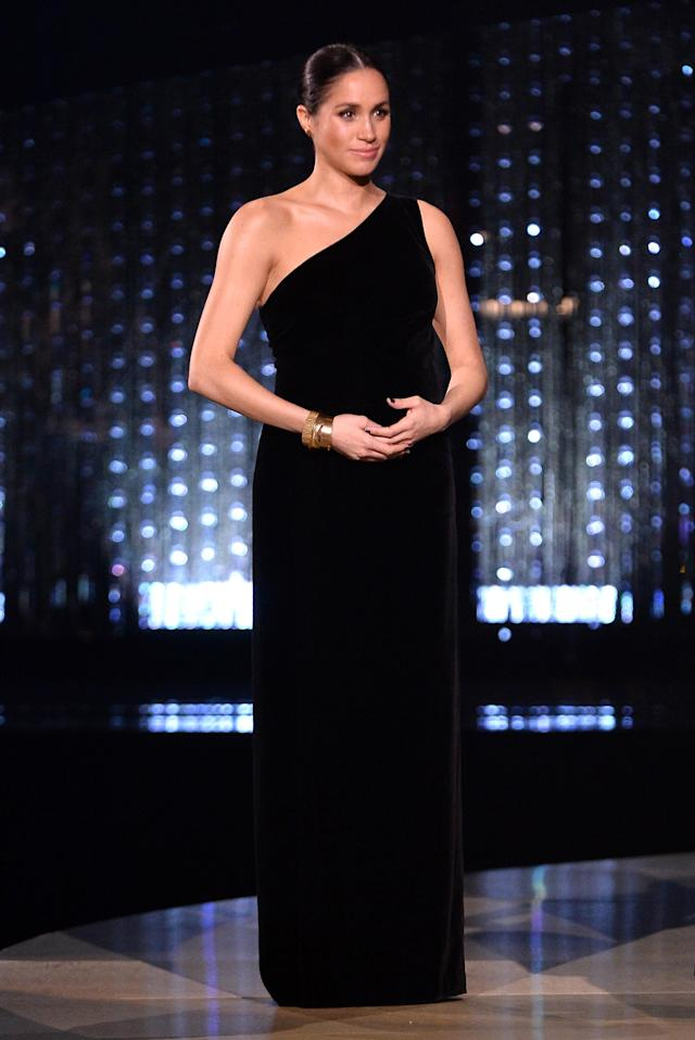 In a surprise move which delighted fashion enthusiasts, the Duchess of Sussex took to the stage at the 2019 Fashion Awards in a one-shoulder Givenchy gown. It proved a fitting choice, as she awarded close friend Clare Waight Keller with the award for Womenswear Designer of the Year. <em>[Photo: Getty]</em>