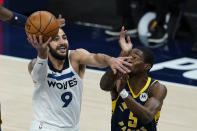 Minnesota Timberwolves' Ricky Rubio (9) goes to the basket against Indiana Pacers' Edmond Sumner (5) during the first half of an NBA basketball game, Wednesday, April 7, 2021, in Indianapolis. (AP Photo/Darron Cummings)