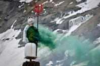 The snowman effigy burns before the fire has reached his fireworks-stuffed head