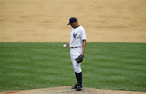 New York Yankees closer Mariano Rivera reacts on the mound after allowing a ninth-inning, game-winning, two-run home run to Baltimore Orioles Adam Jones in a baseball game, Sunday, July 7, 2013, in New York. It was only the second blown save of the season for Rivera. (AP Photo/Kathy Willens)