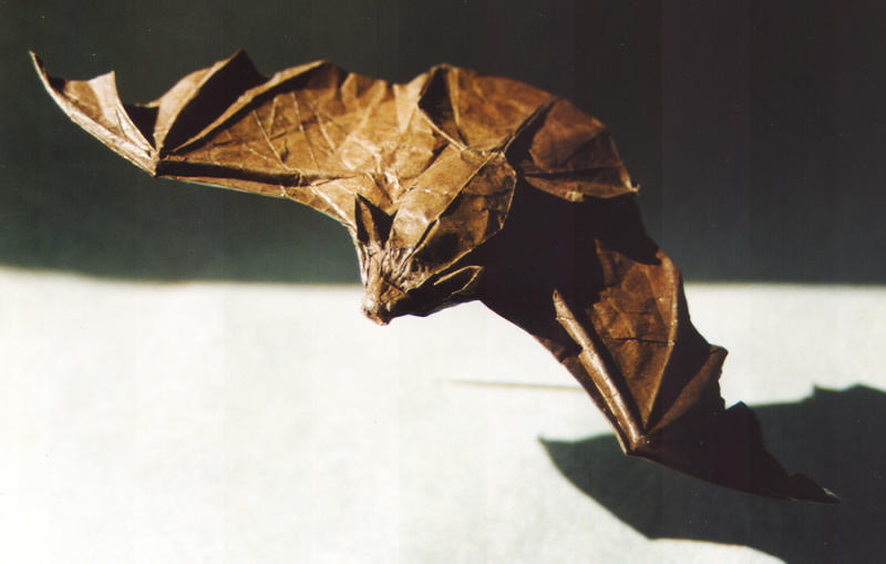 This undated photo courtesy of Origamido in Haverhill, Mass., shows the Big Brown Bat designed by Michael G. LaFosse. He folded the bat from a 12-inch square piece of paper. (AP Photo/Origamido)