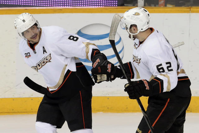 Anaheim Ducks right wing Teemu Selanne (8), of Finland, celebrates with Patrick Maroon (62) after Selanne scored against the Nashville Predators in the second period of an NHL hockey game Thursday, Jan. 9, 2014, in Nashville, Tenn. (AP Photo/Mark Humphrey)