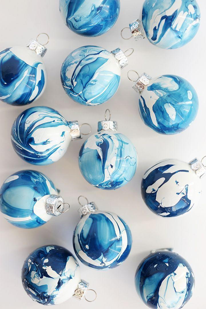 """<p>Looking for a modern addition to your Christmas tree? We suggest these pretty marbled ornaments. Feel free to go for an icy feel with this cool blue hue, or you can choose a seasonal red and green color palette.</p><p><strong>Get the tutorial at <a href=""""https://www.aliceandlois.com/diy-indigo-marbled-ornaments/"""" rel=""""nofollow noopener"""" target=""""_blank"""" data-ylk=""""slk:Alice & Lois"""" class=""""link rapid-noclick-resp"""">Alice & Lois</a>. </strong></p><p><strong><a class=""""link rapid-noclick-resp"""" href=""""https://www.amazon.com/Sally-Hansen-Insta-Matte-Metallics/dp/B07JXVNWYM/ref=sr_1_6?tag=syn-yahoo-20&ascsubtag=%5Bartid%7C10050.g.1070%5Bsrc%7Cyahoo-us"""" rel=""""nofollow noopener"""" target=""""_blank"""" data-ylk=""""slk:SHOP NAIL POLISH"""">SHOP NAIL POLISH</a><br></strong></p>"""