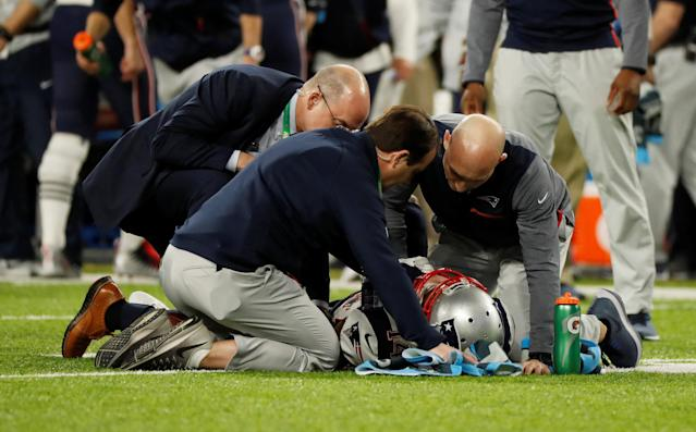 NFL Football - Philadelphia Eagles v New England Patriots - Super Bowl LII - U.S. Bank Stadium, Minneapolis, Minnesota, U.S. - February 4, 2018 New England Patriots' Brandin Cooks receives medical attention after sustaining an injury REUTERS/Kevin Lamarque