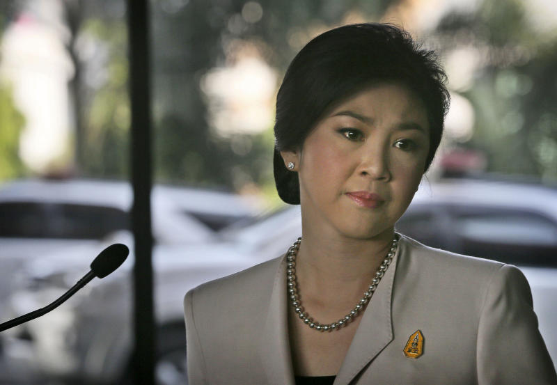 Thailand's Prime Minister Yingluck Shinawatra gets emotional after speaking at a press conference, in Bangkok, Thailand , Tuesday, Dec. 10, 2013. Shinawatra said Tuesday she would not resign ahead of national elections set for Feb. 2, despite opposition demands she step down as the caretaker head of government.(AP Photo/Manish Swarup)