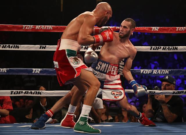 Ray Beltran (L) chases Jose Pedraza Saturday during their WBO lightweight title fight at the Gila River Arena in Glendale, Ariz. Pedraza won the title by unanimous decision. (Getty Images)