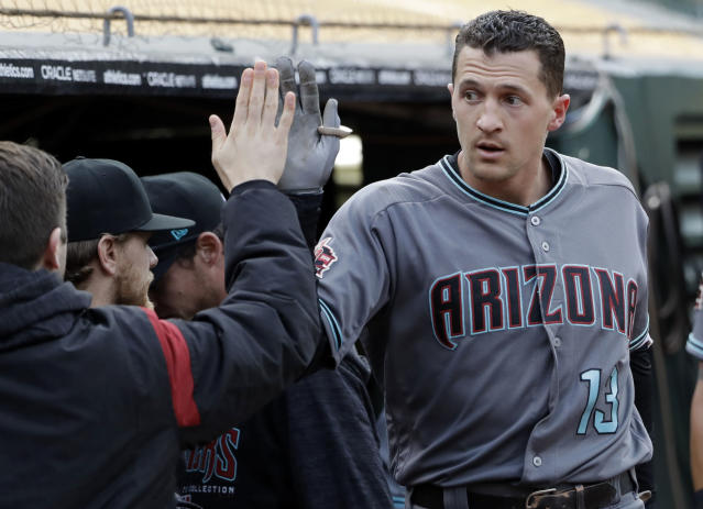 Arizona Diamondbacks' Nick Ahmed receives a high-five in the dugout after hitting a solo home run against the Oakland Athletics during the first inning of a baseball game Friday, May 25, 2018, in Oakland, Calif. (AP Photo/Marcio Jose Sanchez)